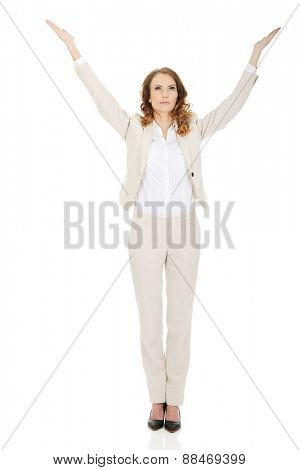 Businesswoman showing something up on open hands.