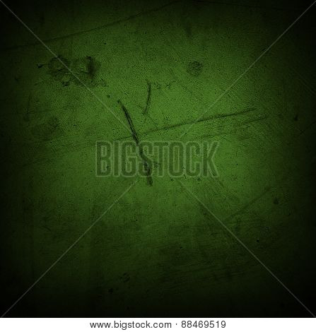 Green grunge textured wall. Dark edges. Advertising copy space
