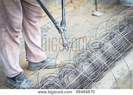 Worker Cut Steel With Iron Scissors In Construction