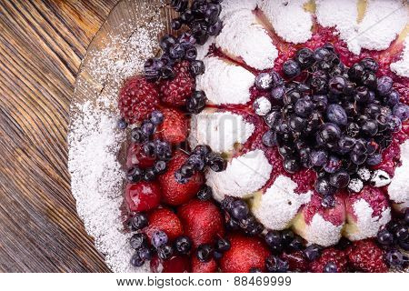 cheesecake  with some fruits on wooden background