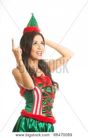 Full length woman wearing elf clothes pointing up.