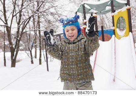 Little Boy On Winter Playground