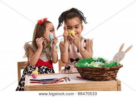 Creative Sisters Painting Easter Eggs