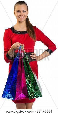 Woman with teeth smile handing shopping bags