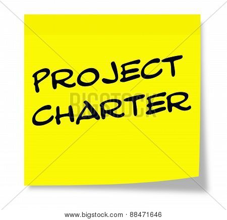 Project Charter Written On A Yellow Sticky Note