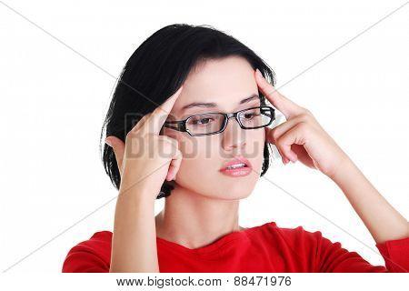 Portrait of worried woman in eyewear.