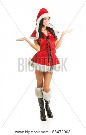 Full length woman with open hands gesture wearing santa clothes.