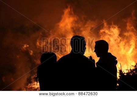 BURG, GERMANY - APRIL 7, 2012: People look at the traditional Easter bonfire in the Lusatian village of Burg in Spreewald Region, Lower Lusatia, Brandenburg, Germany.