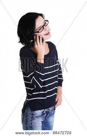 Young smiling woman talking on the phone.