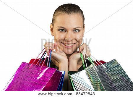 Woman with teeth smile handing bags. Closed up