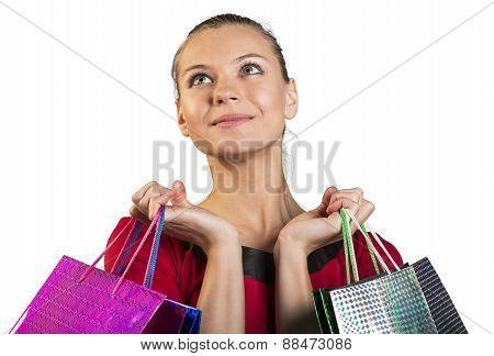 Young lady with smile handing bags. Closed up