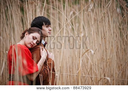 Young Beautiful Couple In The Bulrush