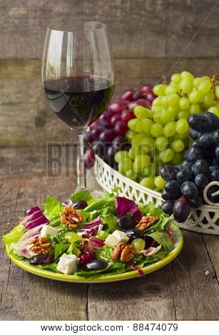 Salad With Grapes, Herbs, Walnuts And Blue Cheese And A Glass Of Wine