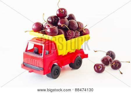 Red Toy Car With A Sweet Cherry