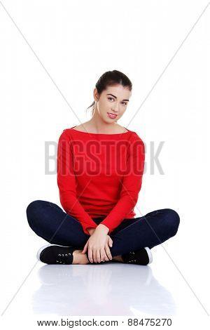 Full length woman sitting cross-legged on the floor