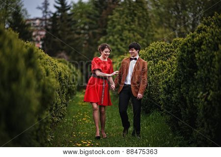 Young Beautiful Couple In The Park