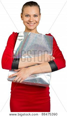 Woman with teeth smile holding shopping bag