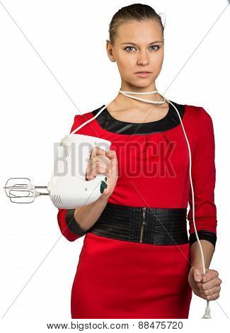 Young woman holding white mixer and pull cord