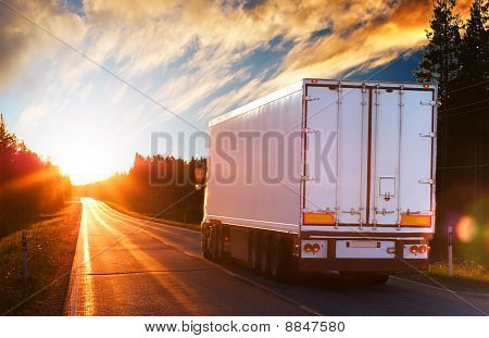 White Truck On The Asphalt Road In The Evening
