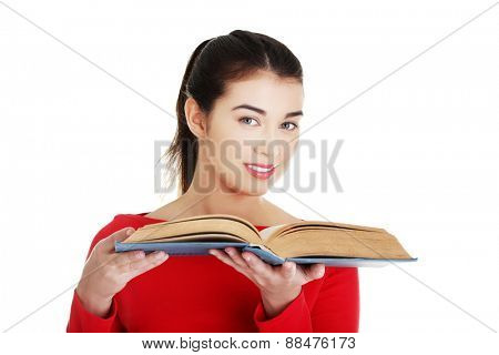 Portrait of student woman holding an open book.