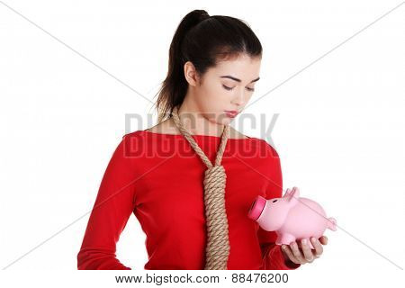 Sad woman with piggybank and rope around neck.