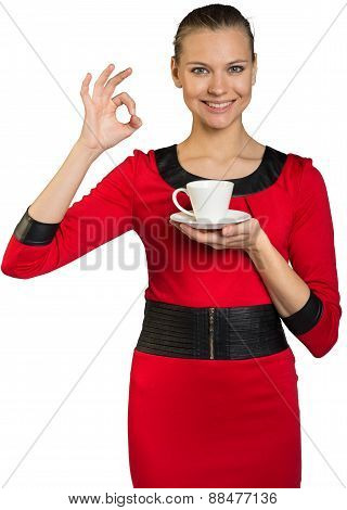 Young smiling woman drinking coffee