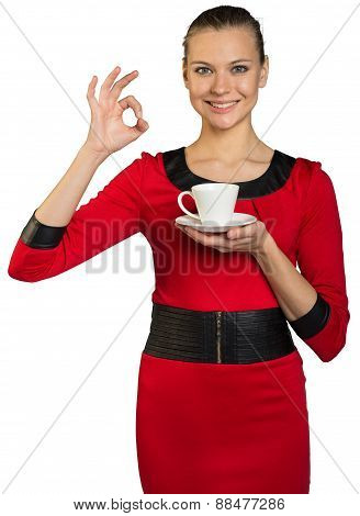Young woman with teeth smile drinking coffee
