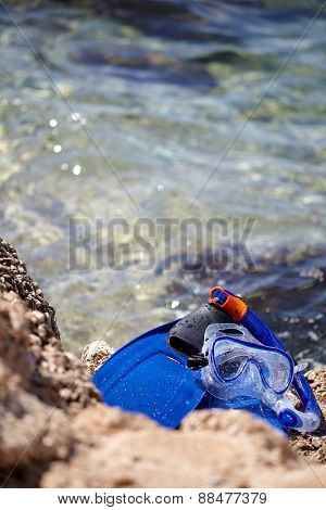 mask, snorkel and fins for snorkeling at the beach