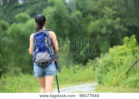 woman hiking at beautiful trail