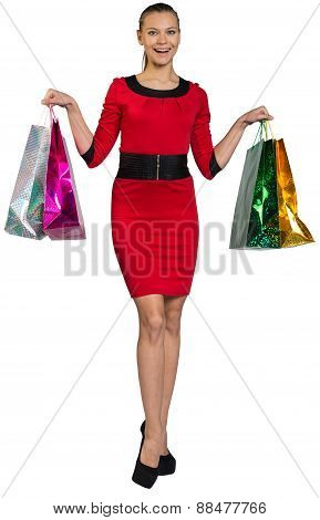 Laughing woman handing bags up