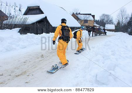 Winter Activities In The Village Snowboarding