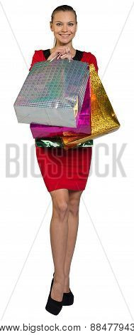 Woman holding shopping bags in front of body