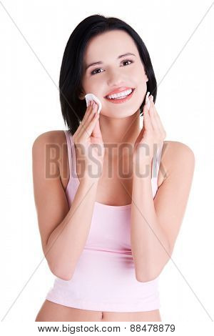Portrait of a woman removing makeup.
