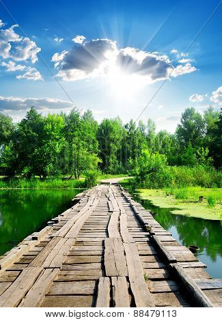 Sun over wooden bridge