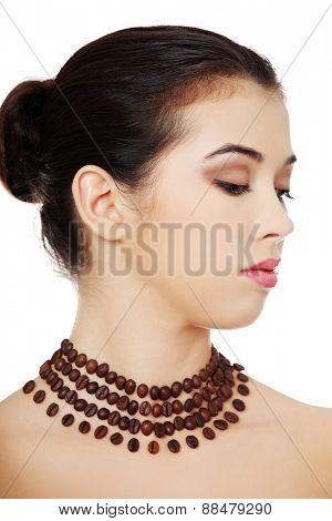 Portrait of a woman wearing beautiful necklace.