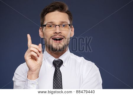 businessman in white shirt and tie on blue background