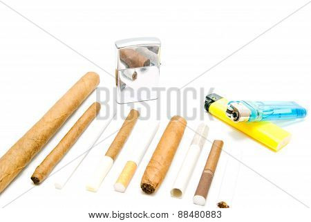 Cigarettes And Various Lighters On White