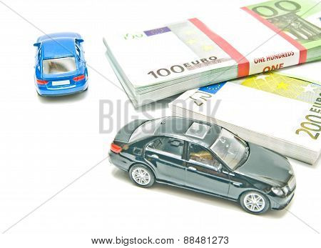 Two Cars On Euro Notes On White