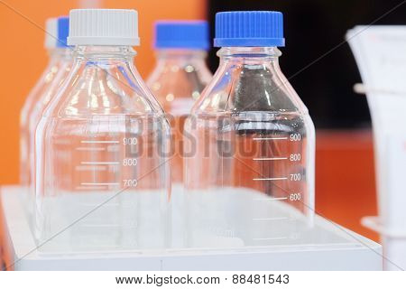 Laboratory equipment. Bottles of chemicals in the laboratory
