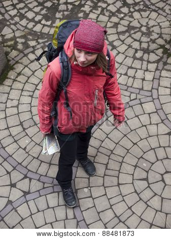 Girl With A Backpack And A Map.