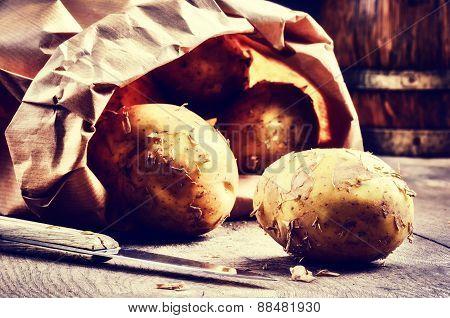 Fresh Potatoes In Brown Paper Bag
