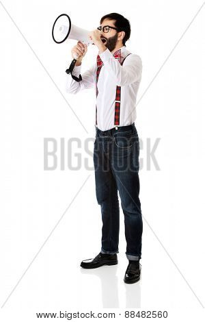 Funny man wearing suspenders shouting with megaphone.