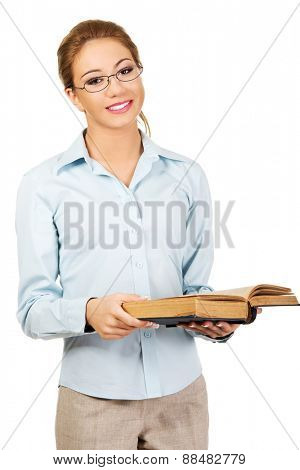 Happy business woman holding a book.