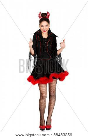Beautiful woman in devil carnival costume with thumbs up.