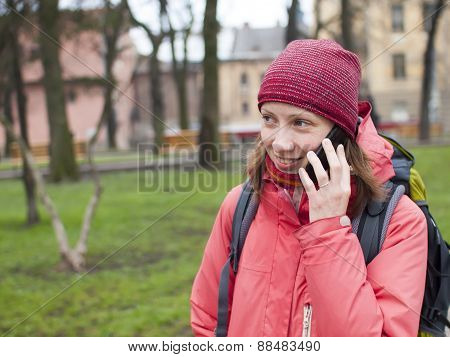 A Young Girl With A Backpack And Phone.