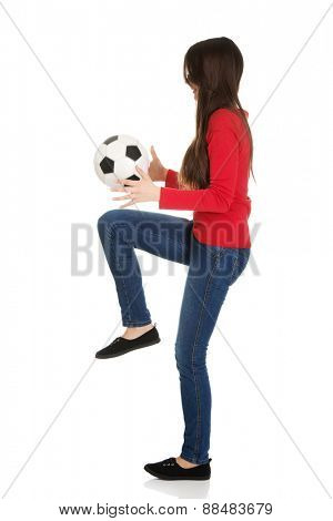 Active woman with a soccer ball.