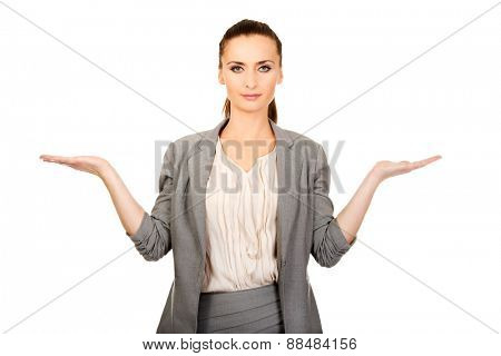 Businesswoman showing two empty hands for product.