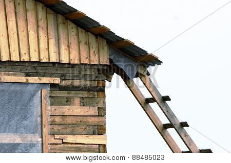 a wooden ladder attached to home under construction