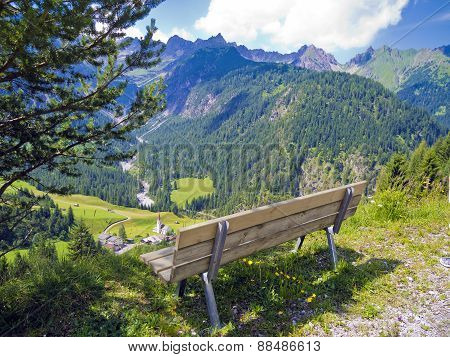 bench for hikers in alpine landscape