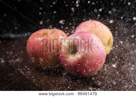 Apple In The Rain On Wooden Table